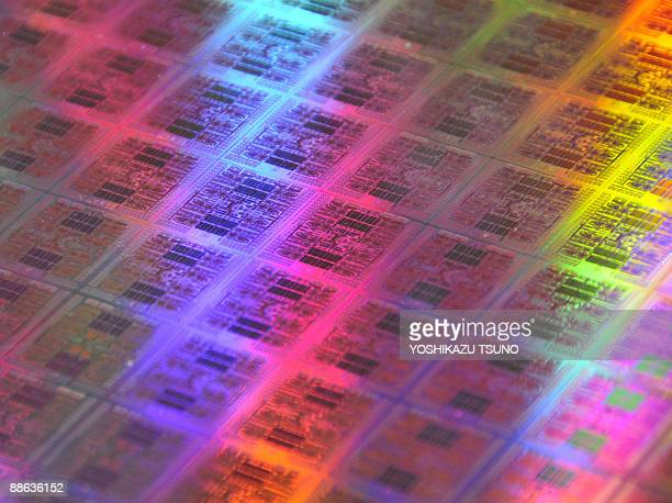 Japan's computer giant Fujitsu runveils a 300mm wafer which has the world's fastest CPU chips 'Venus' with an eightcore Sparc64 architecture...