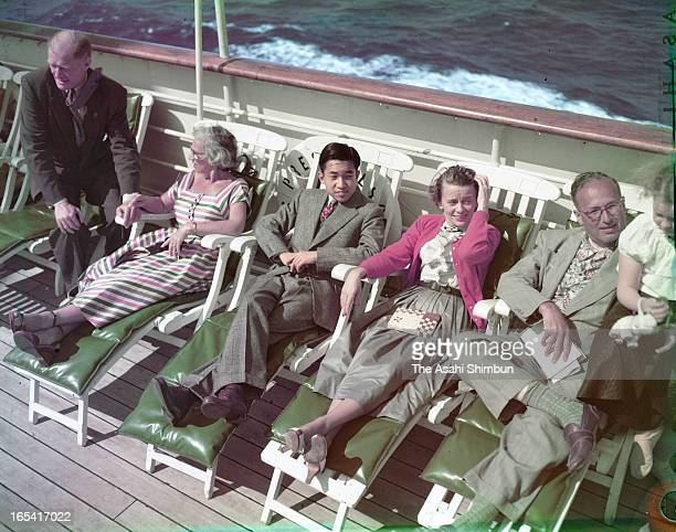 Japan's Crown Prince Akihito lays on a deck chair at a promenade deck of cruise ship President Wilson on the way to San Francisco from Hawaii on...