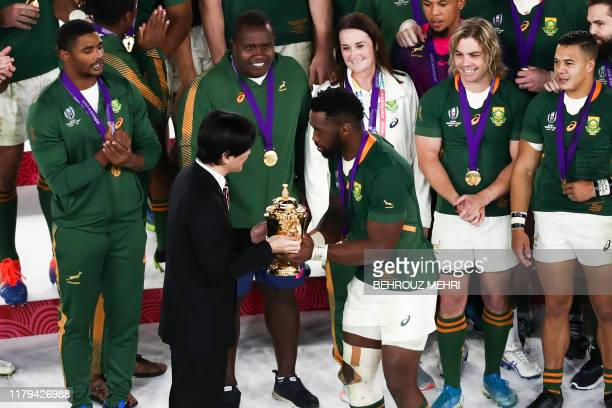 Japan's Crown Prince Akishino presents the Webb Ellis Cup to South Africa's flanker Siya Kolisi as they celebrate winning the Japan 2019 Rugby World...