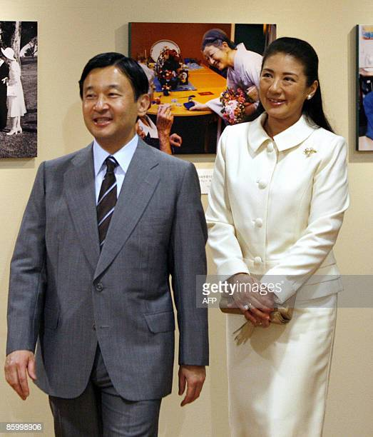 Japan's Crown Prince Naruhito and Crown Princess Masako visit a photo exhibition to celebrate the 50th wedding anniversary and the 20th anniversary...