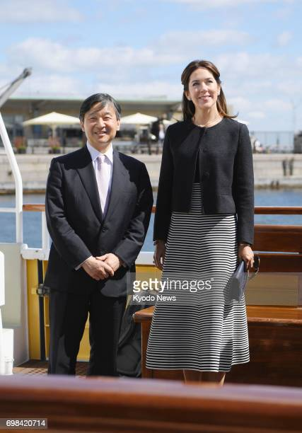 Japan's Crown Prince Naruhito and Denmark's Crown Princess Mary smile aboard a boat for a cruise through Copenhagen harbor on June 20 2017 ==Kyodo