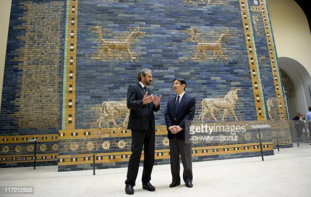 Japan's Crown Prince Naruhito and Hermann Parzinger President of the Prussian Cultural Heritage Foundation stand in front of the Ishtar gate in the...