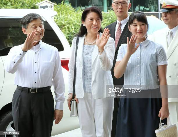 Japan's Crown Prince Naruhito Crown Princess Masako and their daughter Princess Aiko wave to local people as they arrive at IzukyShimoda Station in...