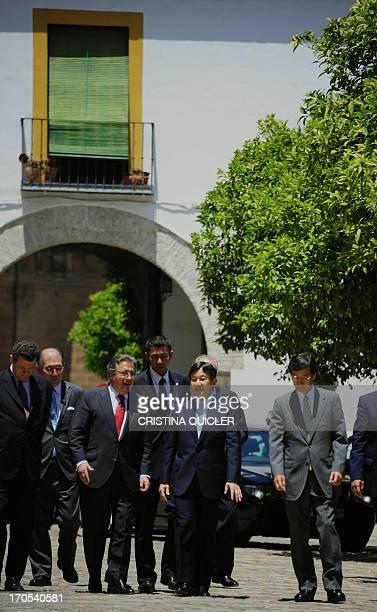 Japan's Crown Prince Naruhito flanked by Sevilla's Mayor Juan Ignacio Zoido visits Los Reales Alcazares de Sevilla in Sevilla on June 14 2013 Crown...
