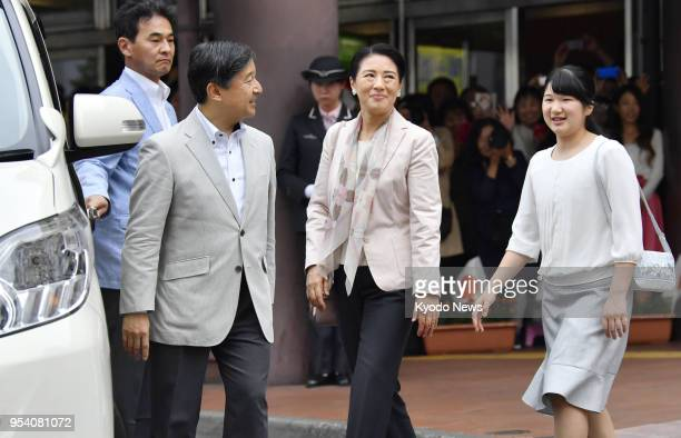 Japan's Crown Prince Naruhito his wife Crown Princess Masako and daughter Princess Aiko head toward Imperial Stock Farm in Tochigi Prefecture after...