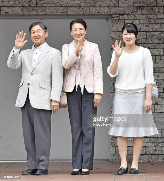 Japan's Crown Prince Naruhito his wife Crown Princess Masako and daughter Princess Aiko wave in front of JR Utsunomiya station on their way to...