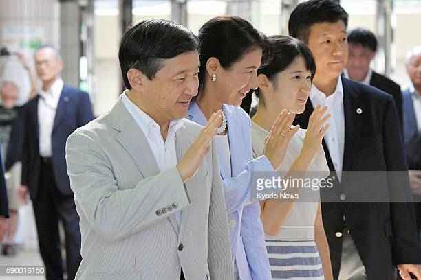 Japan's Crown Prince Naruhito his wife Crown Princess Masako and their daughter Princess Aiko wave to wellwishers as they arrive at Izukyu Shimoda...