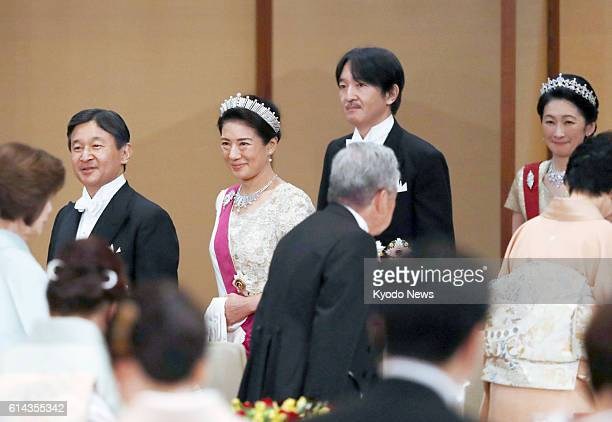 Japan's Crown Prince Naruhito, his wife Crown Princess Masako, Prince Akishino and his wife Princess Kiko attend a banquet at the Imperial Palace in...