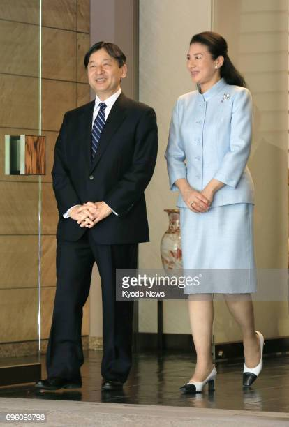 Japan's Crown Prince Naruhito is seen off by his wife Crown Princess Masako at their residence in Tokyo on June 15 before leaving for a weeklong trip...
