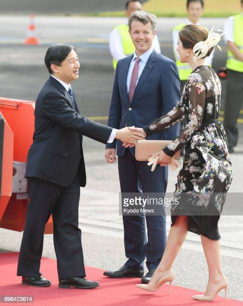 Japan's Crown Prince Naruhito is welcomed by Denmark's Crown Prince Frederik and Crown Princess Mary after arriving in Copenhagen on June 15 for a...