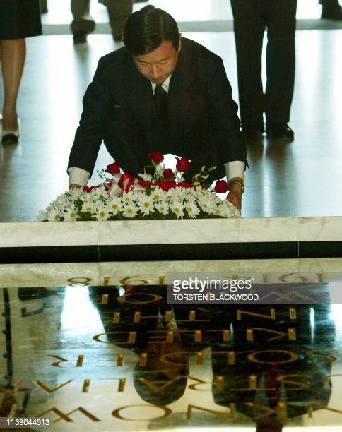 Japan's Crown Prince Naruhito lays a wreath at The Tomb of the Unknown Soldier at the Australian War Memorial in Canberra 18 December 2002 The...