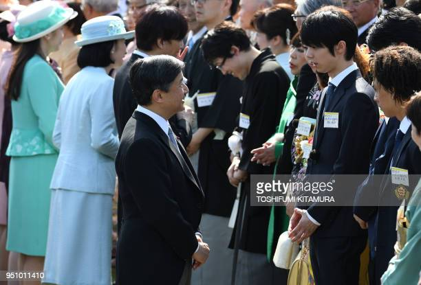 Japan's Crown Prince Naruhito speaks with medallists from the Pyeongchang Winter Olympic Games including figure skater Yuzuru Hanyu during the spring...