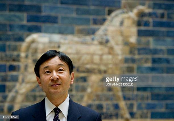 Japan's Crown Prince Naruhito stands in front of the Ishtar gate in the Pergamon museum on June 24 2011 in Berlin Naruhito is on a threeday visit to...