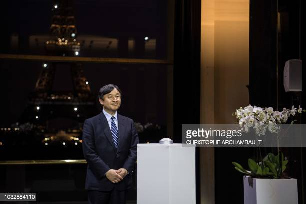 Japan's Crown Prince Naruhito stands on a podium before launching a light show on the Eiffel Tower on September 13 in Paris Japan's Crown Prince is...