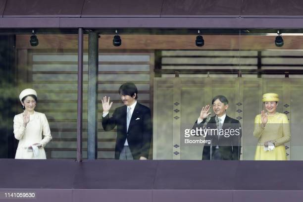 Japan's Crown Princess Kiko from left Crown Prince Akishino Emperor Naruhito and Empress Masako wave during a greeting ceremony at the Imperial...