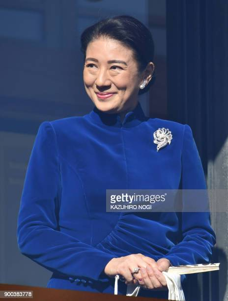 Japan's Crown Princess Masako smiles during the royal family's annual New Year's greeting to wellwishers gathered at the Imperial Palace in Tokyo on...