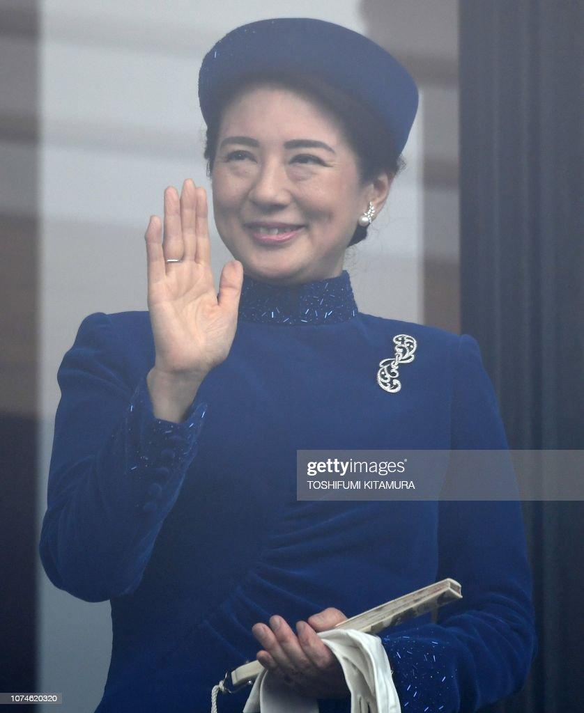 japans-crown-princess-masako-waves-during-emperor-akihitos-birthday-picture-id1074620320