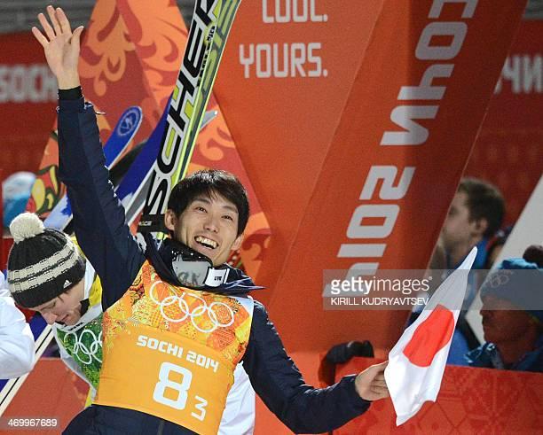 Japan's Daiki Ito celebrates winning bronze to win gold in the Men's Ski Jumping Team Final Round at the RusSki Gorki Jumping Center during the Sochi...