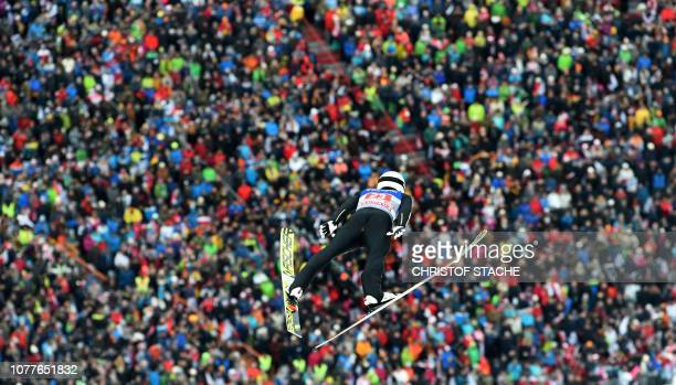 TOPSHOT Japan's Daiki Ito soars over spectators during his first competition jump at the third stage of the FourHills Ski Jumping tournament in...