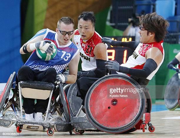 Japan's Daisuke Ikezaki and Yukinobu Ike block Christophe Salegui of France during a pool phase group B wheelchair rugby match at the Rio de Janeiro...