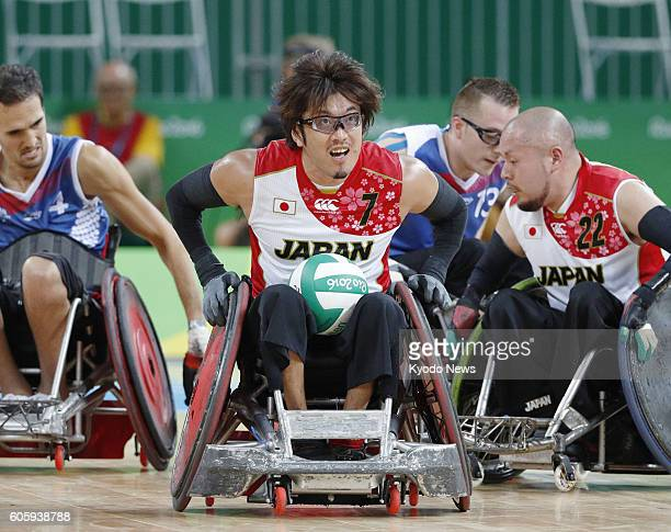 Japan's Daisuke Ikezaki carries the ball during a pool phase group B wheelchair rugby match against France at the Rio de Janeiro Paralympics on Sept...