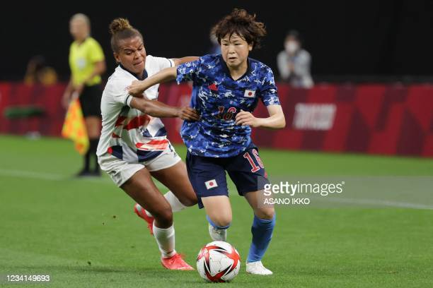 Japan's defender Asato Miyagawa fights for the ball Britain's forward Nikita Parris during the Tokyo 2020 Olympic Games women's group E first round...