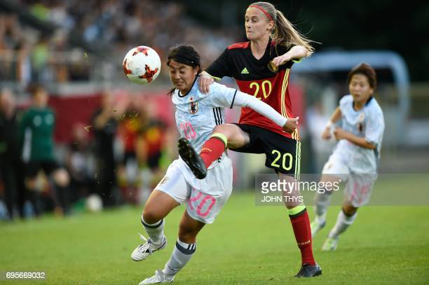 Japan's defender Ayumi Oya vies with Belgium's midfielder Julie Biesmans during the Women's International friendly football match between Belgium and...