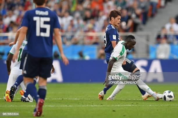 Japan's defender Hiroki Sakai vies with Senegal's midfielder Papa Alioune Ndiaye during the Russia 2018 World Cup Group H football match between...