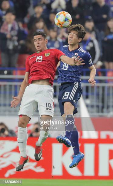 Japan's defender Koki Anzai and Bolivia's forward Leonardo Vaca fight for the ball during their international friendly football match in Kobe on...