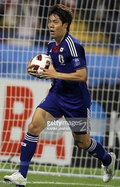 Japan's defender Masahiko Inoha runs with the ball after scoring his team's third goal against Qatar during their 2011 Asian Cup quarter-final...