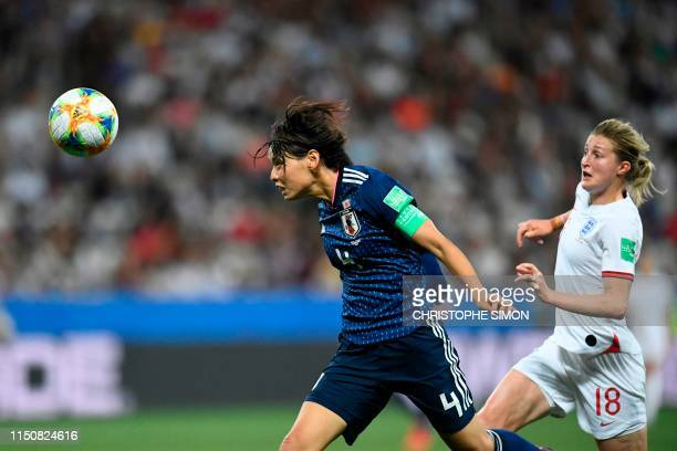 Japan's defender Saki Kumagai heads the ball during the France 2019 Women's World Cup Group D football match between Japan and England, on June 19 at...