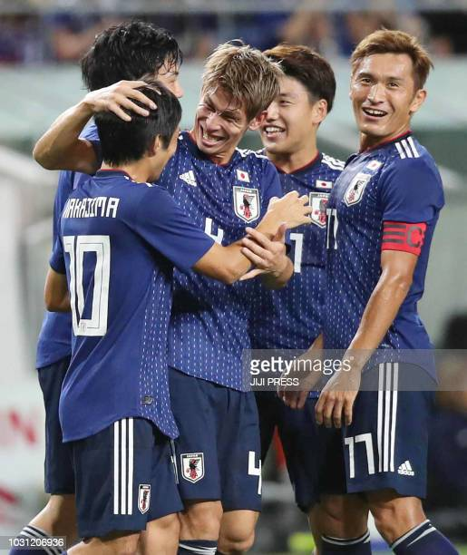 Japan's defender Sho Sasaki celebrates his team's first goal with teamates during their friendly football match between Japan and Costa Rica in Osaka...