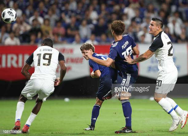 Japan's defender Sho Sasaki shoots the ball past Costa Rica's defender Keyner Brown during their friendly football match between Japan and Costa Rica...