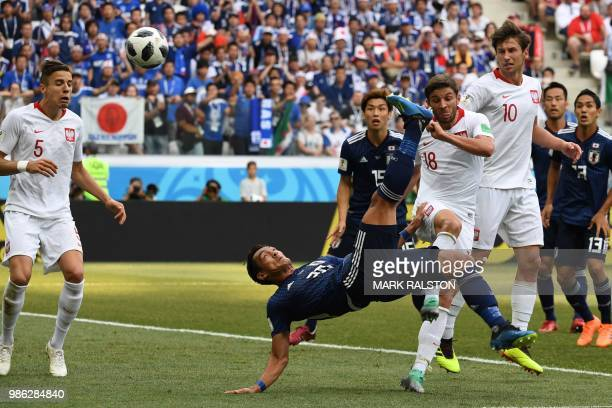 Japan's defender Tomoaki Makino kicks the ball during the Russia 2018 World Cup Group H football match between Japan and Poland at the Volgograd...