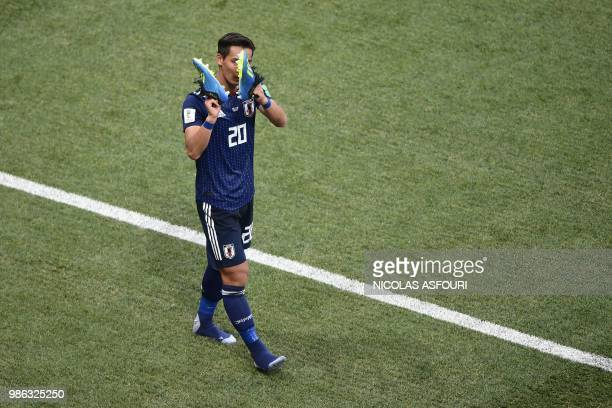 TOPSHOT Japan's defender Tomoaki Makino reacts after the final whistle of the Russia 2018 World Cup Group H football match between Japan and Poland...