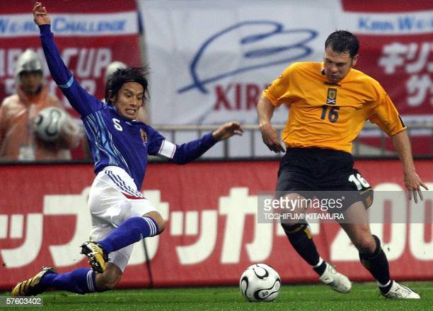 Japan's defender Tsuneyasu Miyamoto and Scotland's defender Graeme Murty fight for the ball during the second half of their Kirin Cup soccer match...