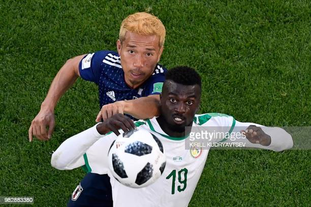 Japan's defender Yuto Nagatomo vies with Senegal's forward Mbaye Niang during the Russia 2018 World Cup Group H football match between Japan and...