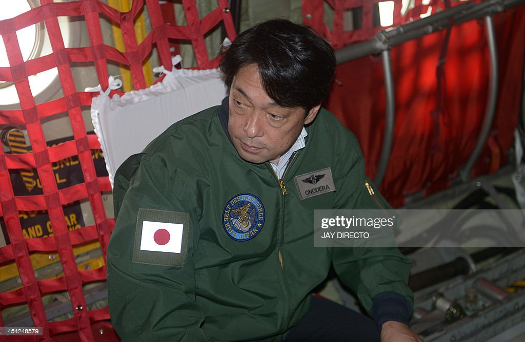 Japan's Defense Minister Itsunori Onodera rides on board a Japanese C-130 cargo plain to Tacloban on December 8, 2013, which was devastated by Super Typhoon Haiyen that hit the central Philippines on November 8. The super typhoon has left almost 7,000 dead and missing after its rampage through the central Philippines in November. AFP PHOTO / Jay DIRECTO