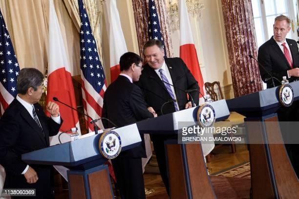 Japan's Defense Minister Takeshi Iwaya and acting US Secretary of Defense Patrick Shanahan watch as Japan's Foreign Minister Taro Kono and US...