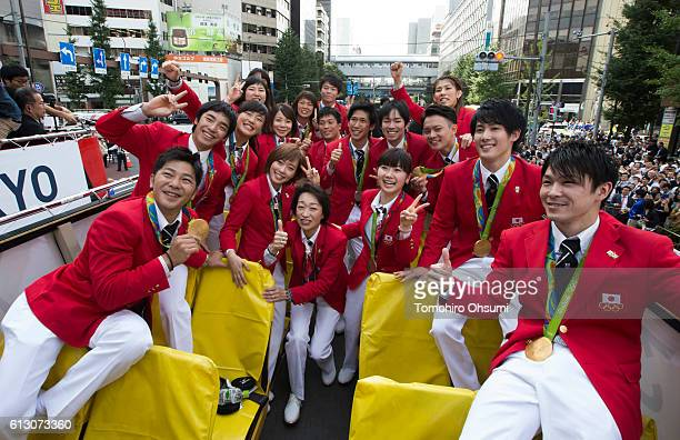 Japan's delegation chief Seiko Hashimoto center poses for a photograph with medalists on the top of a double decker bus during the Rio Olympics 2016...