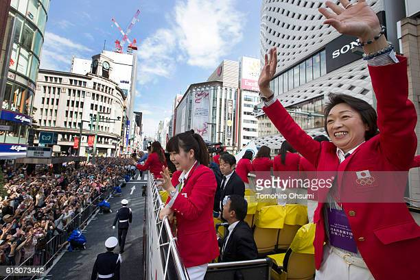 Japan's delegation chief Seiko Hashimoto right and Ai Fukuhara second from right wave from the top of a double decker bus during the Rio Olympics...
