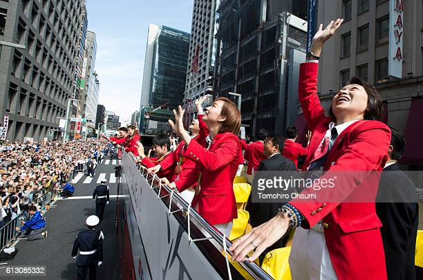 Japan's delegation chief Seiko Hashimoto right and Kasumi Ishikawa second from right wave from the top of a double decker bus during the Rio Olympics...