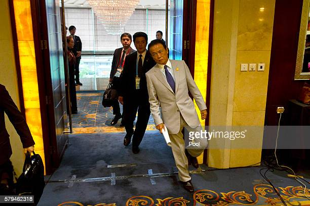 Japan's Deputy Prime Minister Taro Aso arrives for a press conference held at the close of the G20 Finance Ministers and Central Bank Governors...