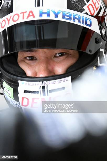 Japan's driver Kamui Kobayashi reacts and leaves his Toyota TS050 Hybrid N°7 during the fourth qualifying practice session of the Le Mans 24 hours...