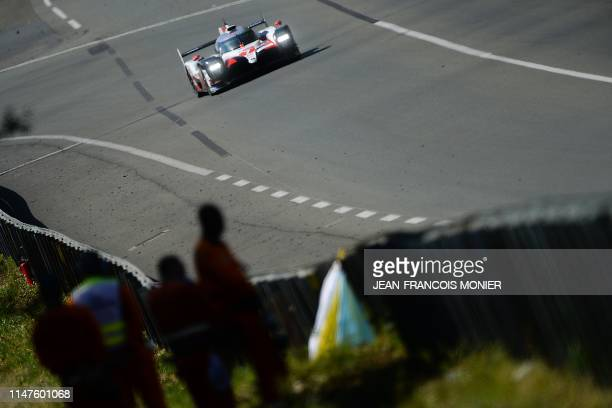 TOPSHOT Japan's driver Kamui Kobayashi steers his Toyota TS050 Hybrid LMP1 during the circuit test day at Le Mans in northwestern France prior to the...