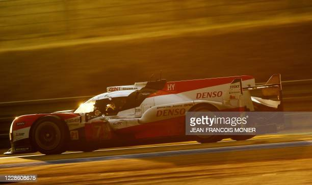 Japan's driver Kamui Kobayashi steers his Toyota TS050 Hybrid LMP1 WEC during the 88th edition of the Le Mans 24 Hours endurance race, at Le Mans...