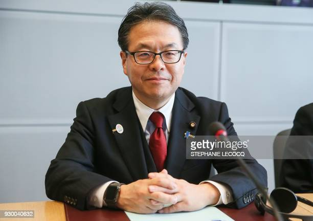 Japan's Economy Minister Hiroshige Seko poses at the begining of a meeting with European Commissioner for Trade and US trade representative for talks...