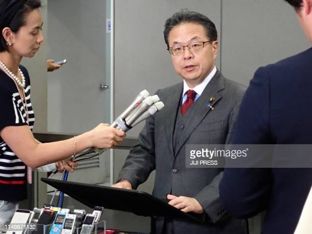 Japan's Economy Trade and Industry Minister Hiroshige Seko speaks to journalists during a press briefing at the Ministry of Economy Trade and...