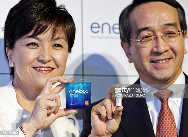 Japan's electrnonics giant Sanyo Electric CEO Tomoyo Nonaka and executive officer Mitsuru Honma display the new rechargeable nickel metal hydride...