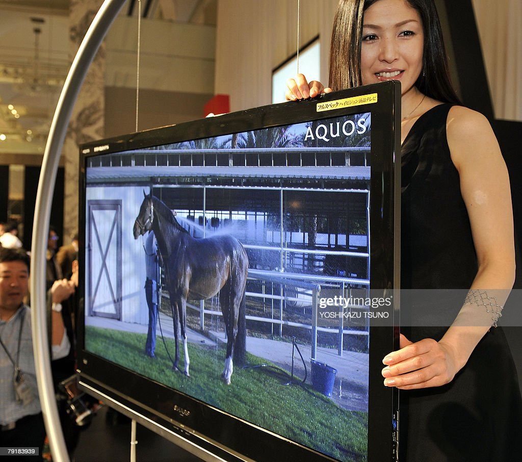 Japan's electroinics giant Sharp unveils the world's thinest LCD televisions 'Aquos X-series', which has a 46, 42 and 37-inch size screens and a 3.44cm in thickness with full high-definition quailty in Tokyo, 24 January 2008. Sharp will put it on the market from March 01. AFP PHOTO / Yoshikazu TSUNO